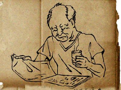 新聞を読みながらお茶を飲む祖父